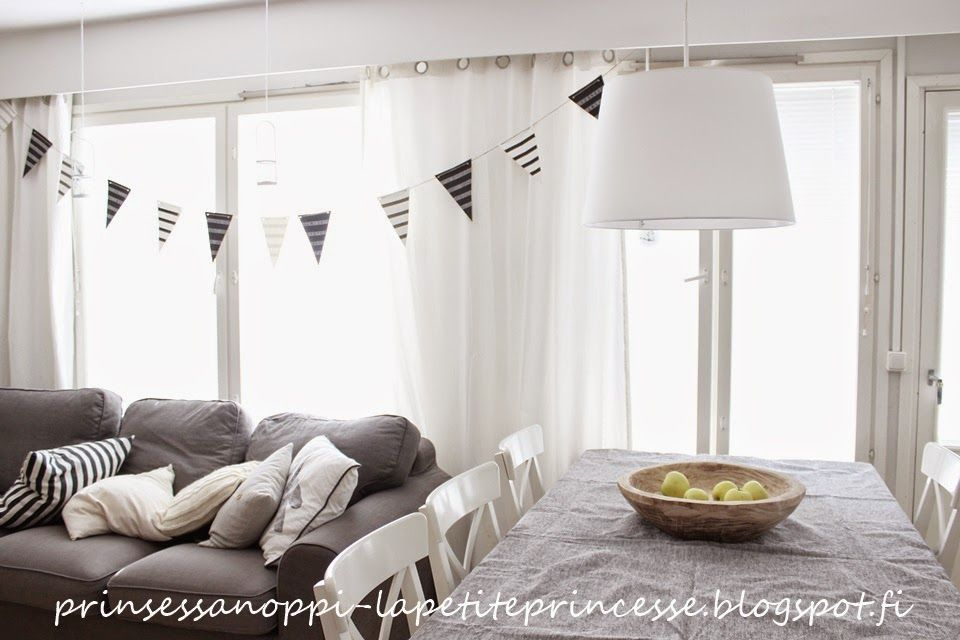 Dining space in living room. Black and white, bunting and linen table cloath