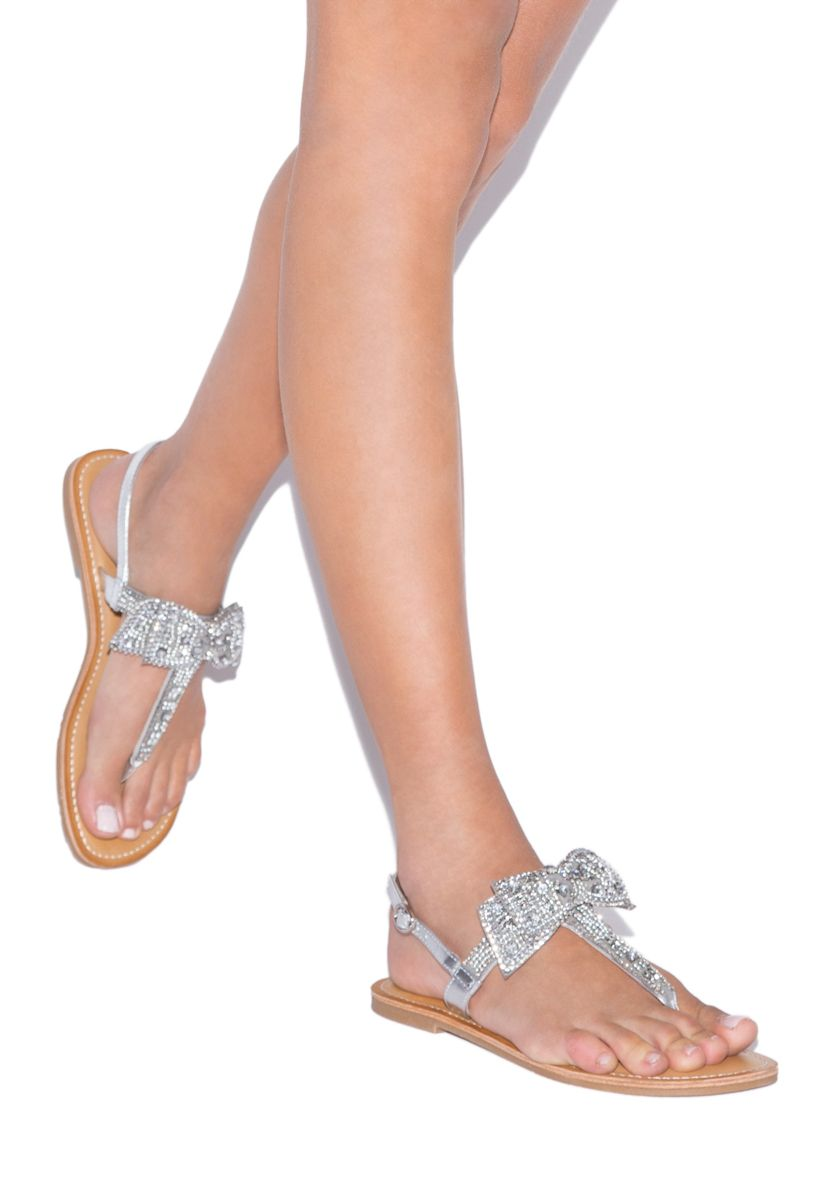 c4569578a Let your girly side shine bright in the rhinestone-encrusted Terena sandal.  The T-strap features a two-layered bejeweled bow that will dress up any  outfit.