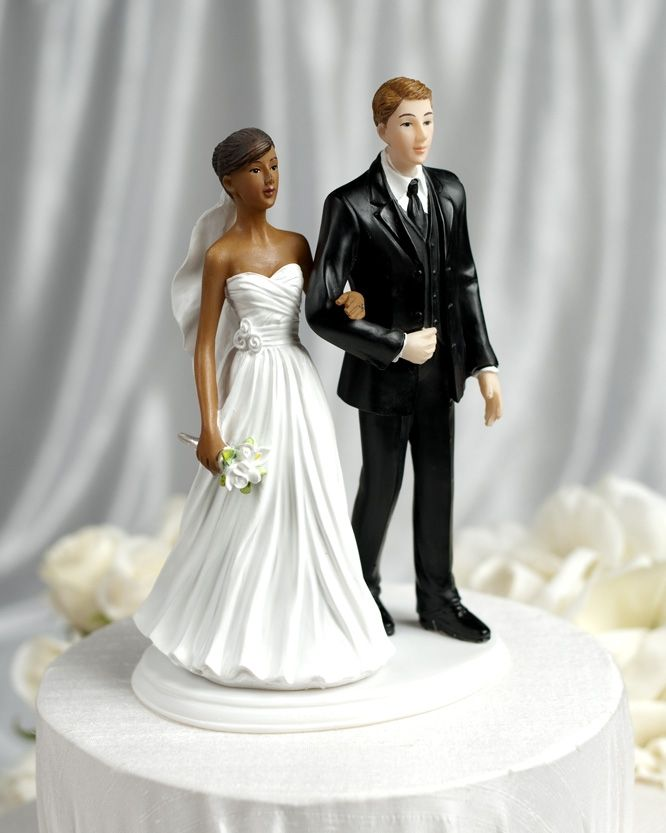 Interracial bride and groom wedding cake topper are