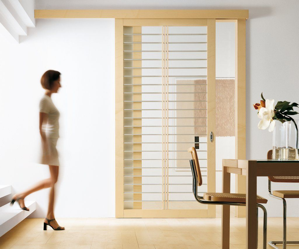 Wonderful barn door sliding room divider with clear glass for Interior sliding glass doors room dividers
