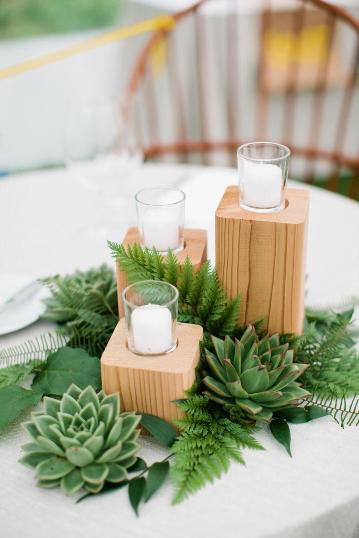 Wooden candle holders with greenery centerpieces pinterest