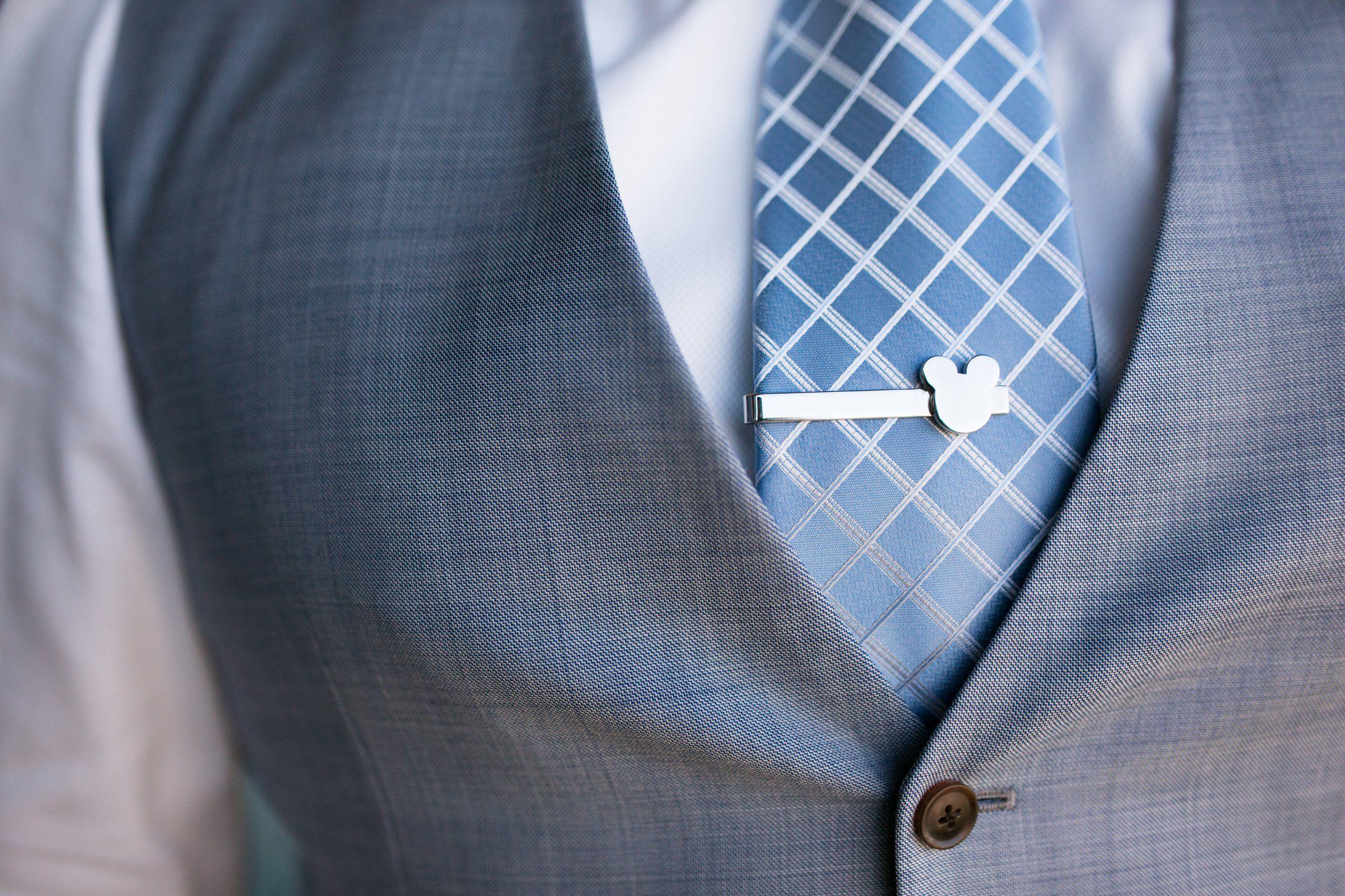A tiny hidden Mickey on this groom's tie clip