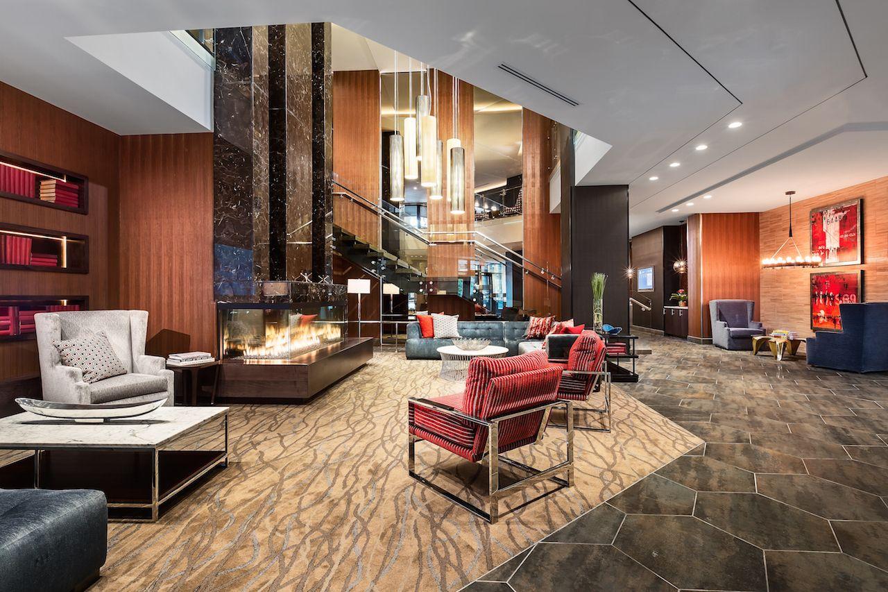 Lobby Seating Area Farmhouse stools, Luxury apartments