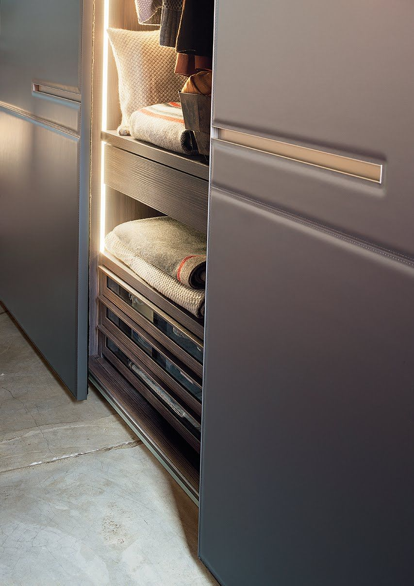 a warm, welcoming lema wardrobe - leather sliding doors with
