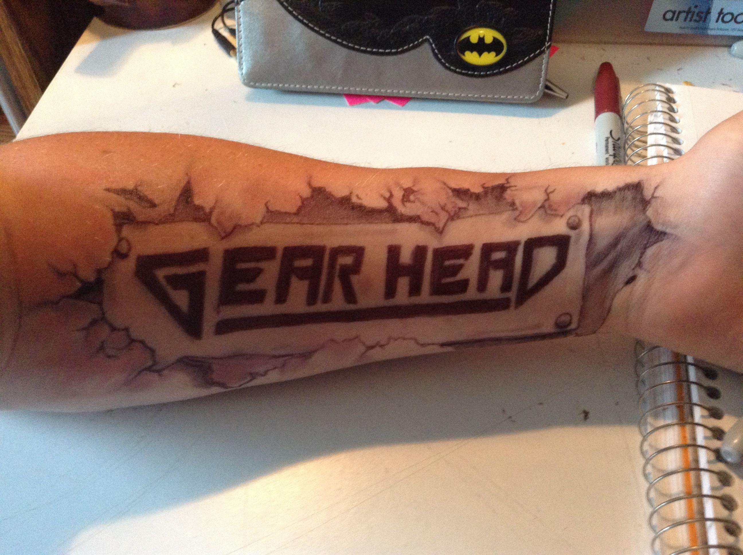 Photo of Gear head tattoo, drawn by Ryan Seufzer