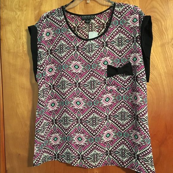 NWT Forever 21 Shirt New with tags Forever 21 shirt. Made out of 100% polyester and has a pocket on the front with a bow. Super cute! Forever 21 Tops Blouses