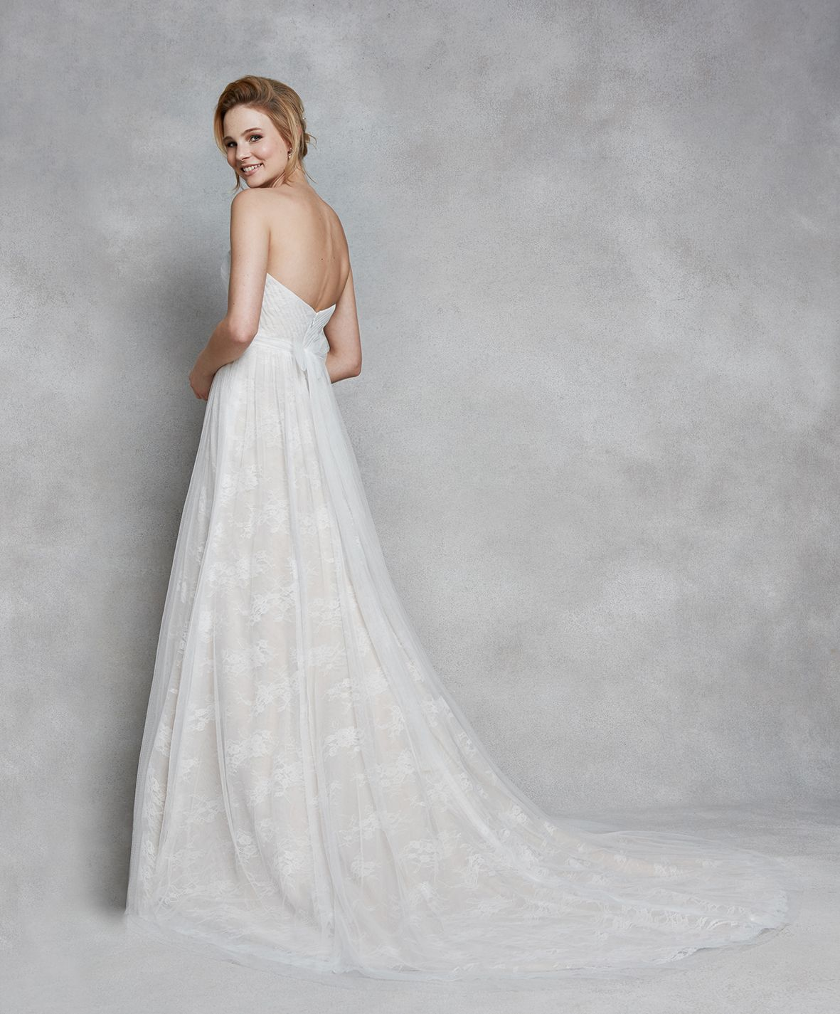 Cairou this enchanting strapless gown blends dainty chantilly lace