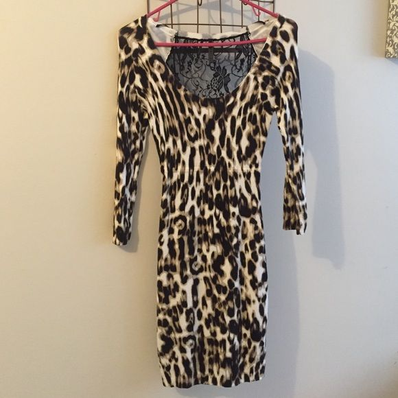 0720e4384495 Guess Leopard Print Dress w/ lace cutout Leopard print dress with black lace  cutout in the back. Size small. Stretchy sweater material with  three-quarter ...