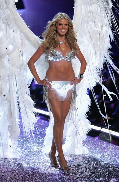 5ca7ec08f8 Heidi Klum wows the Victoria Secret s runway show in this light-up  gem-studded white bikini with wings.
