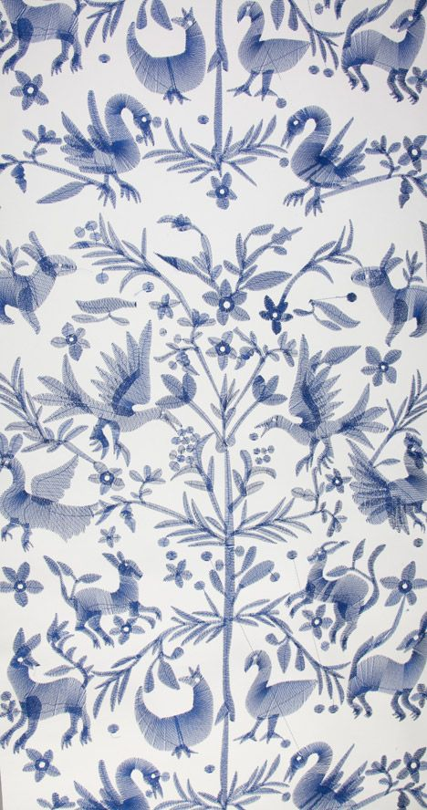 Traditional embroidery patterns combine with digital stitching technology in this embroidered wallpaper