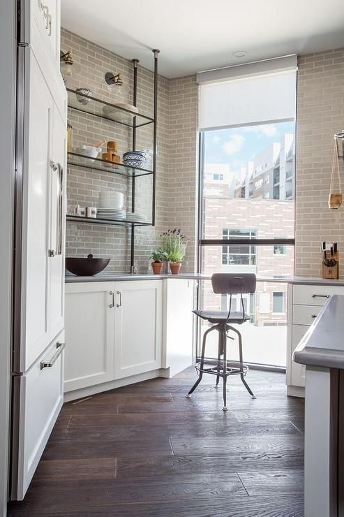 Chic angled kitchen pantry features a floor to ceiling ...