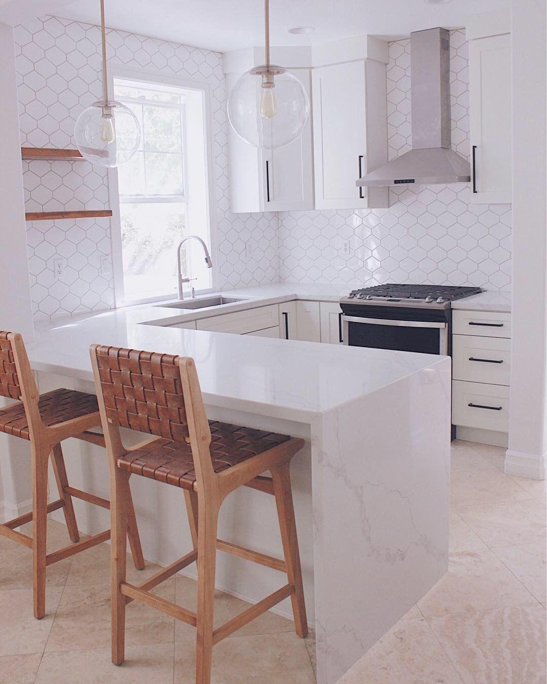 Modern White Kitchen with Matte Black Hardware, Floating
