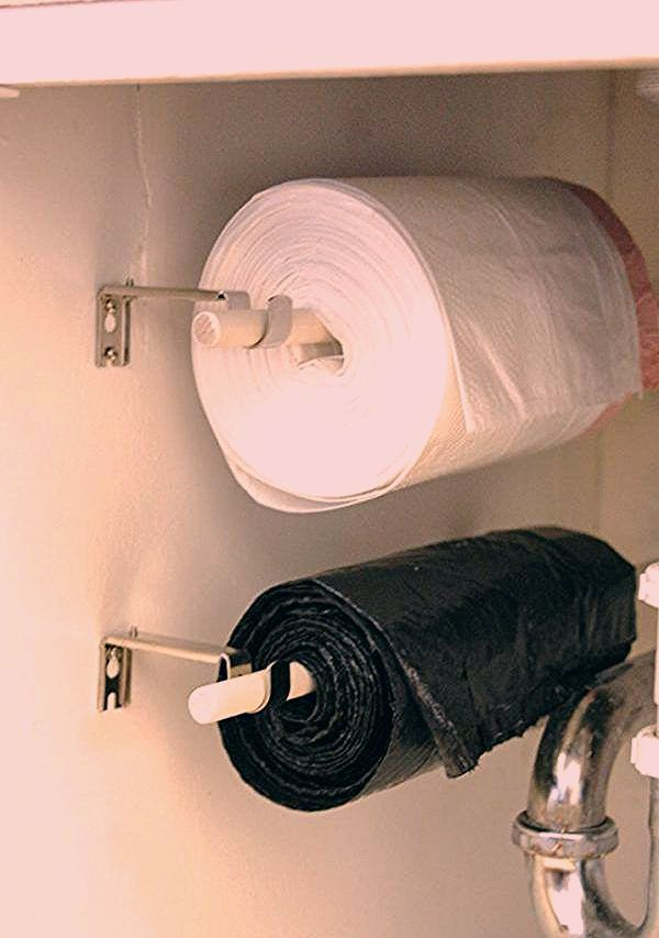 Hang Trash Bags On A Roll Under The Sink - 23 Shockingly Easy DIY Kitchen Organization Ideas You Need To Try Today. If you have been looking for kitchen organization ideas then you will lose these storage ideas for your kitchen. You can use cheap dollar store items to transform your cupboards, countertops, pantry and under the sink area with these life hacks.#kitchenideas #kitchen #organisation #organization #storage