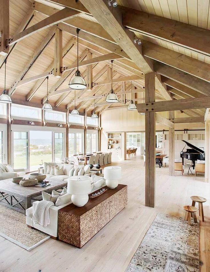 Barn house vaulted ceilings living room a beach barn for Open floor plans with vaulted ceilings