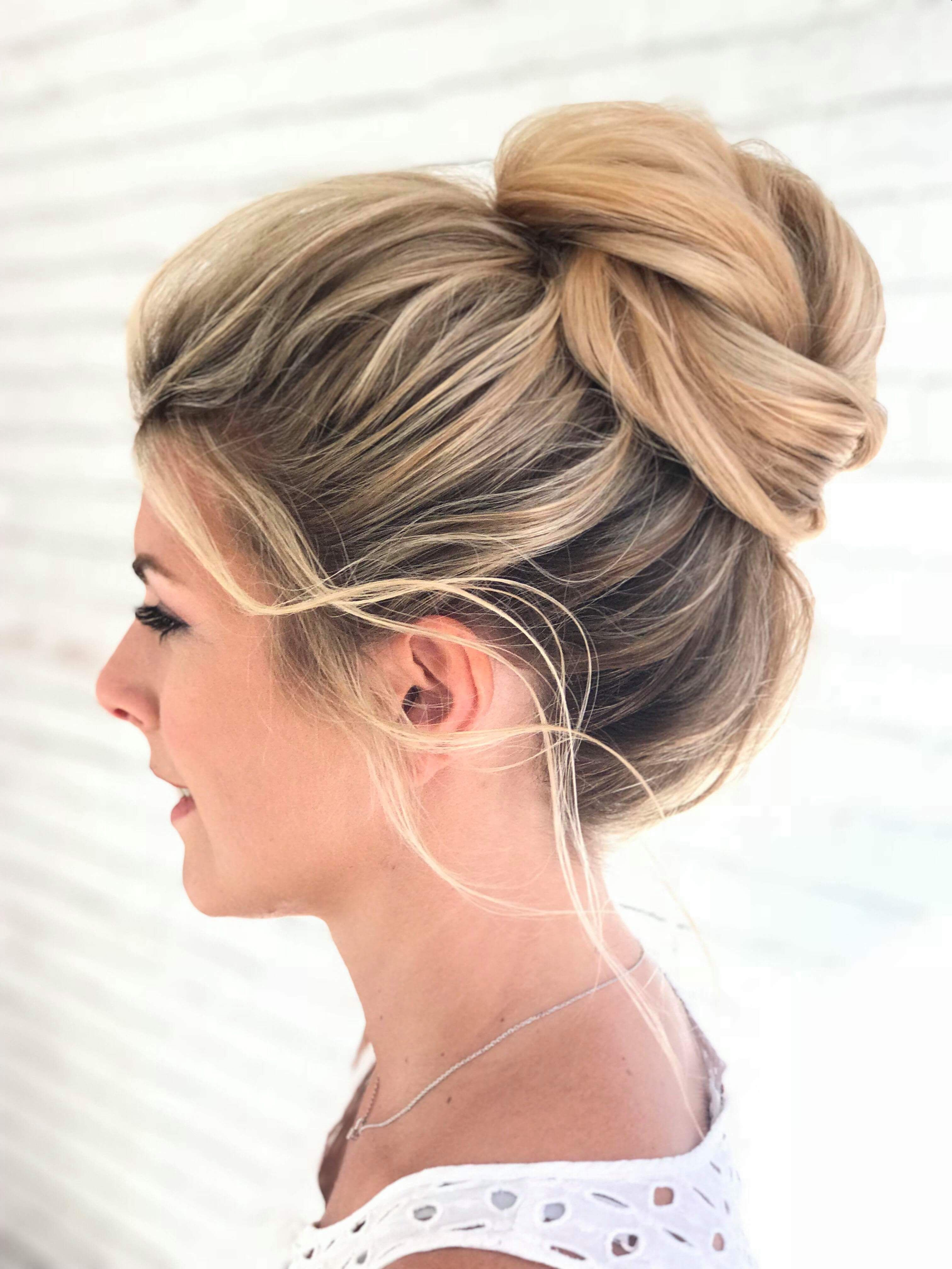 messy high bun on blonde highlighted hair, gorgeous for a