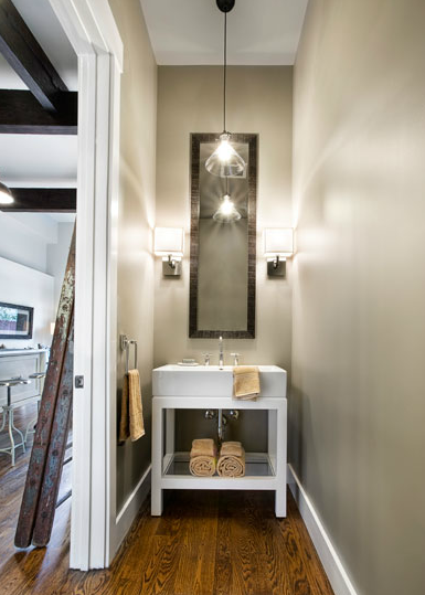 Long, narrow powder room with taupe paint color and rustic ...