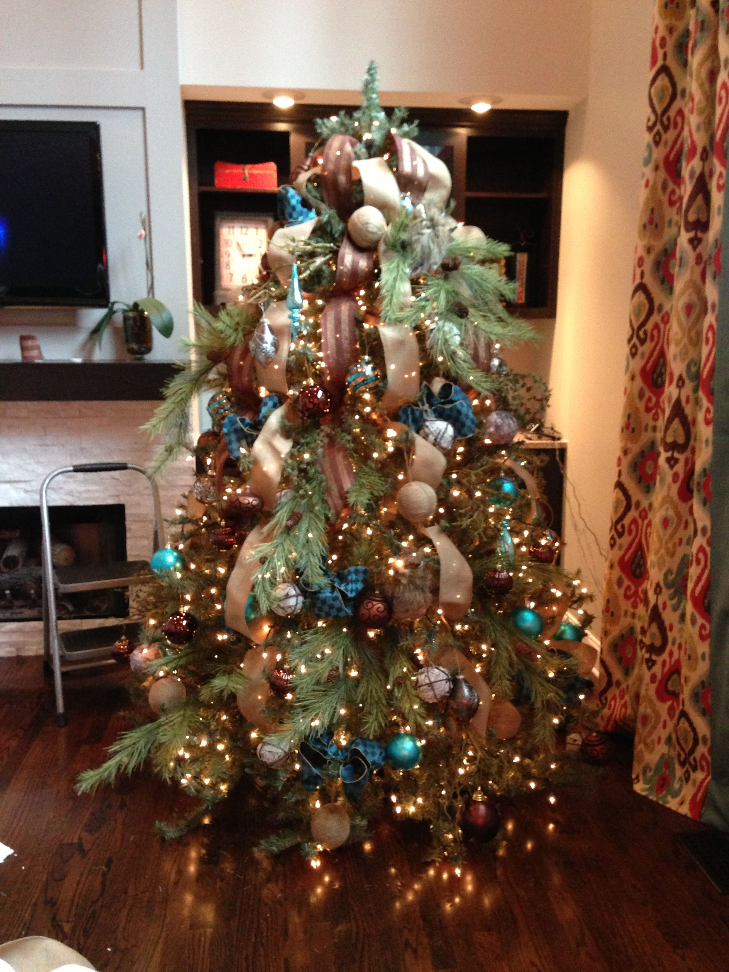 j truan interiors burlap teals browns and natural elements make up this - Christmas Decorating Services