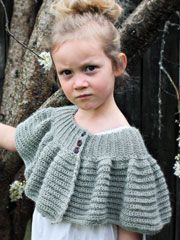A ribbed neckline yoke completed with rows of half double crochets make this capelet easy to make. A perfect wrap to keep the chill off! Instructions are included for sizes NB to Ladies XL.