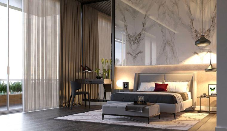 Idee arredamento camera da letto parete marmo letto testa tessuto