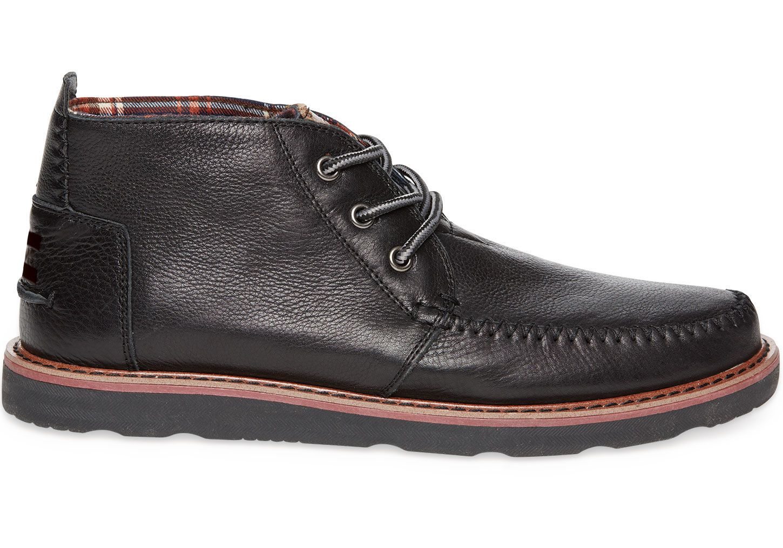 Black leather versatile, low-profile Chukka men's boot symbolizes ...