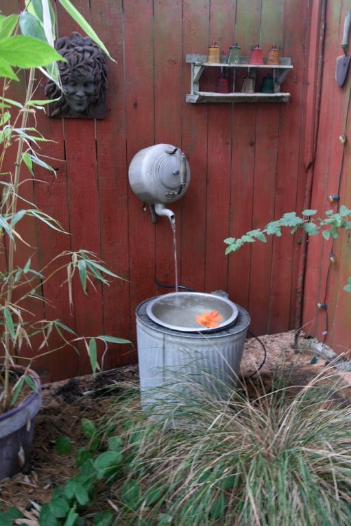 Teakettle fountain. Great repurposing idea!