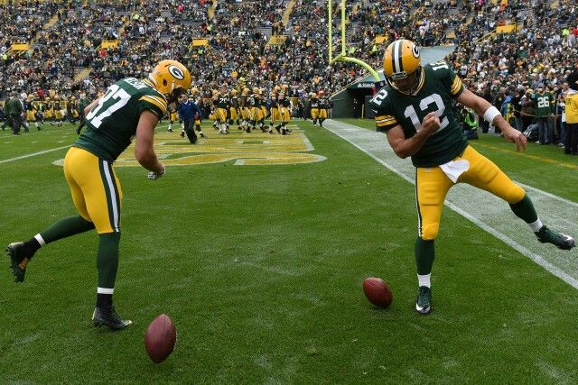 Jordy Nelson And Aaron Rodgers Spinning Footballs Before The Game