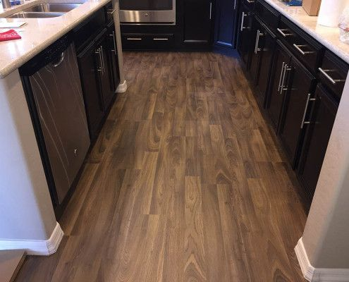 laminate and wood flooring in kitchen gainey flooring solutions - Kitchen Floor Solutions