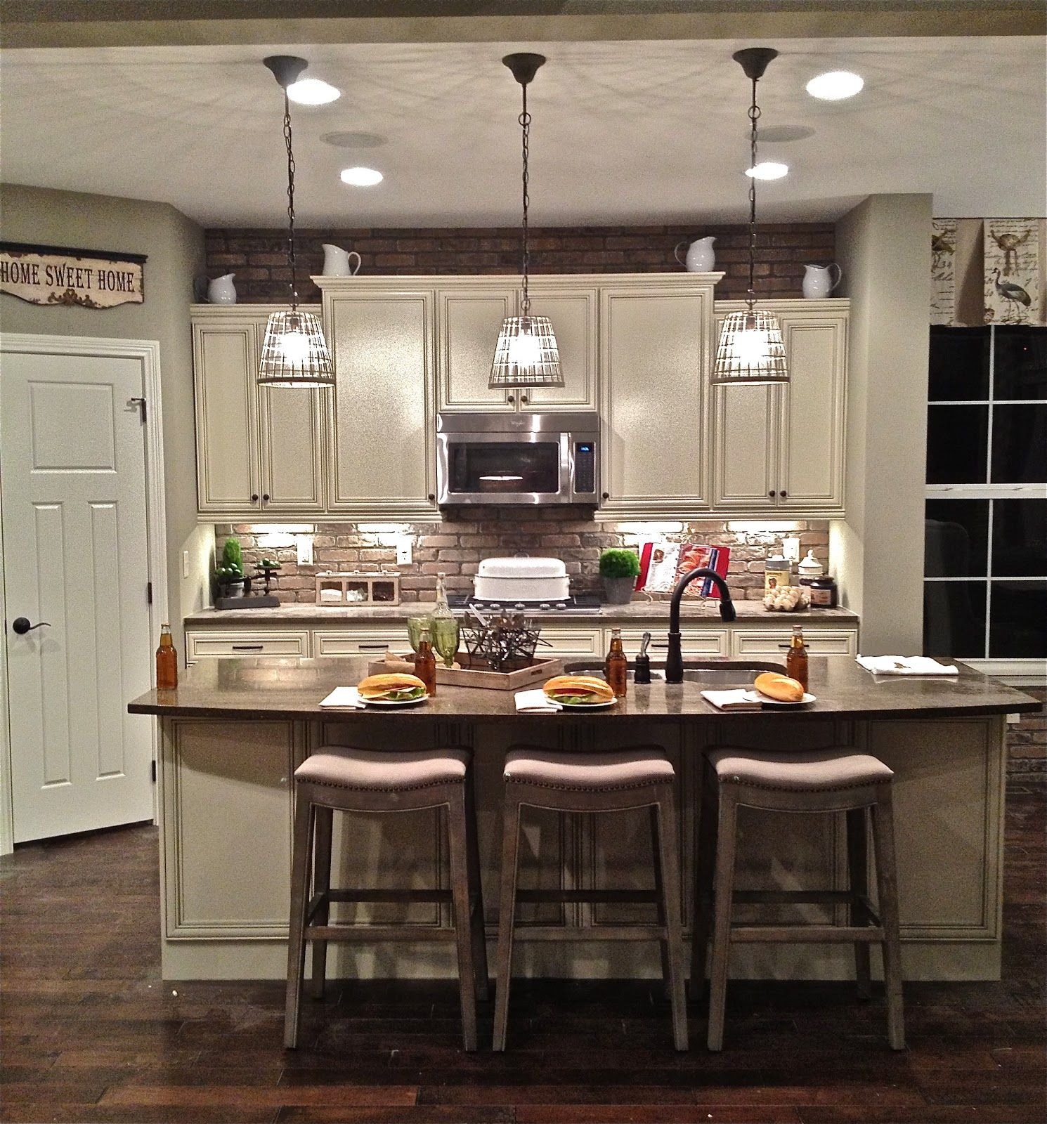 Interior Triple Cage Pendant Island Lighting Over Large Kitchen Island And Wooden Stools As Well Kitchen Remodel Layout Kitchen Design Modern Kitchen Lighting Three pendant kitchen light