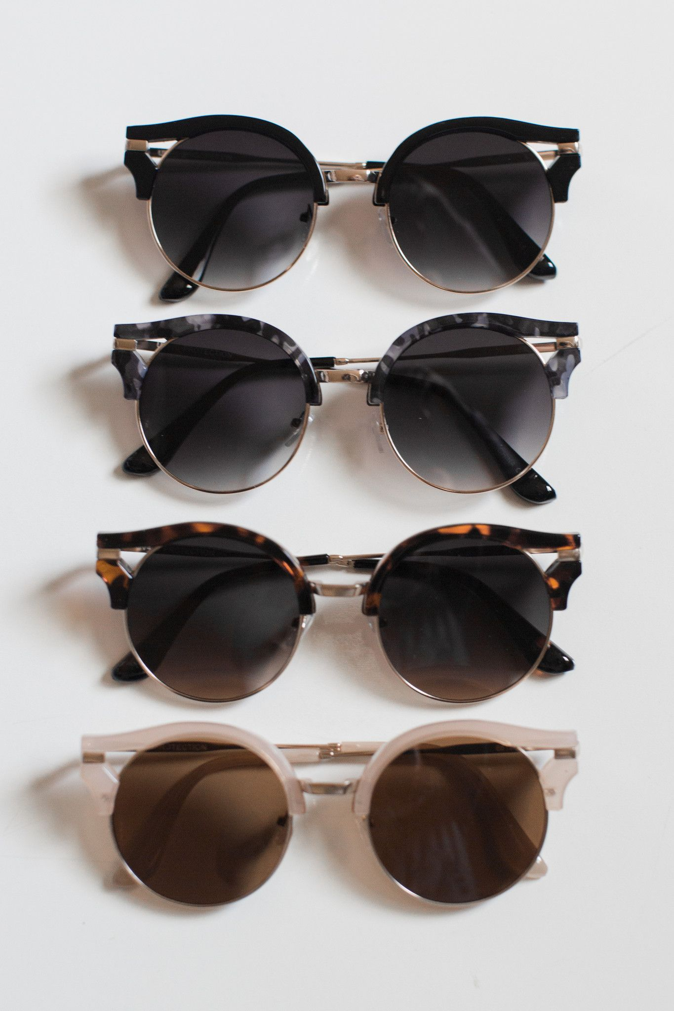 """Vintage inspired round frame sunnies. Measures approx. 5.5"""" x 2.2"""". 100% UV protection. Colors (from top to bottom): Black, Grey, Brown, Peach - Imported"""