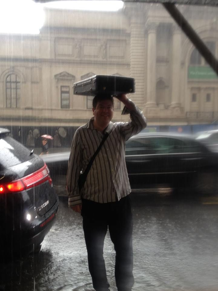 Life on the road with a double violin case... I suppose I'd have been wetter with a shaped one (my thanks to Jennifer Meagher for taking this whilst safely sheltered under a brolly).