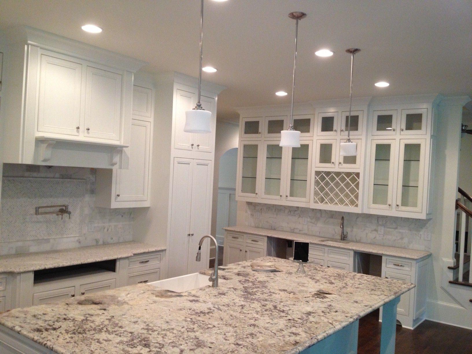 Attractive White Granite Countertops For Bright Kitchen Exciting White Granite Countertops And White Kitchen Cabinet With Tile Backsplash