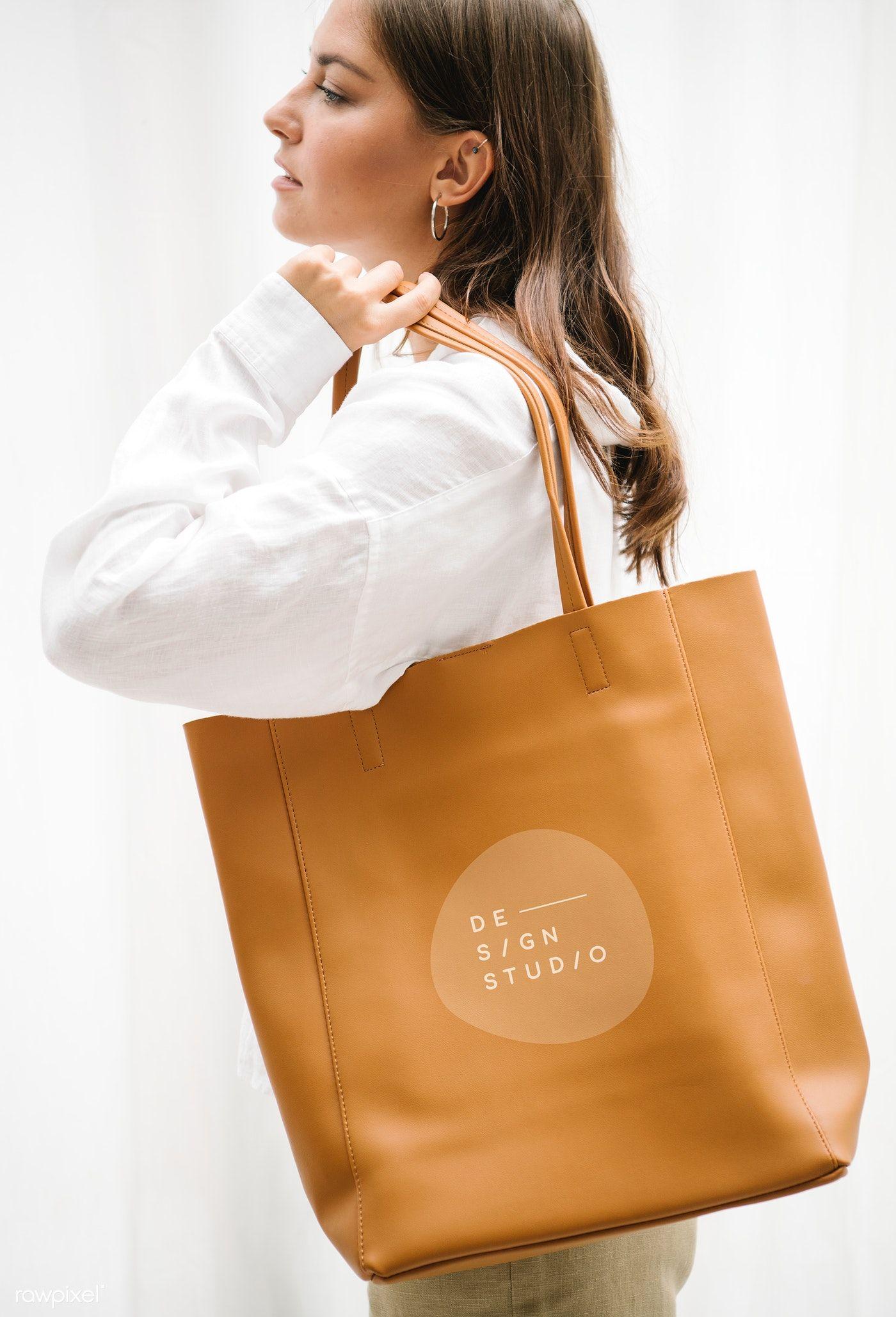 Download Download Premium Psd Of Woman Carrying A Brown Handbag Mockup 1215167 Brown Handbag Tan Leather Bag Design Mockup Free