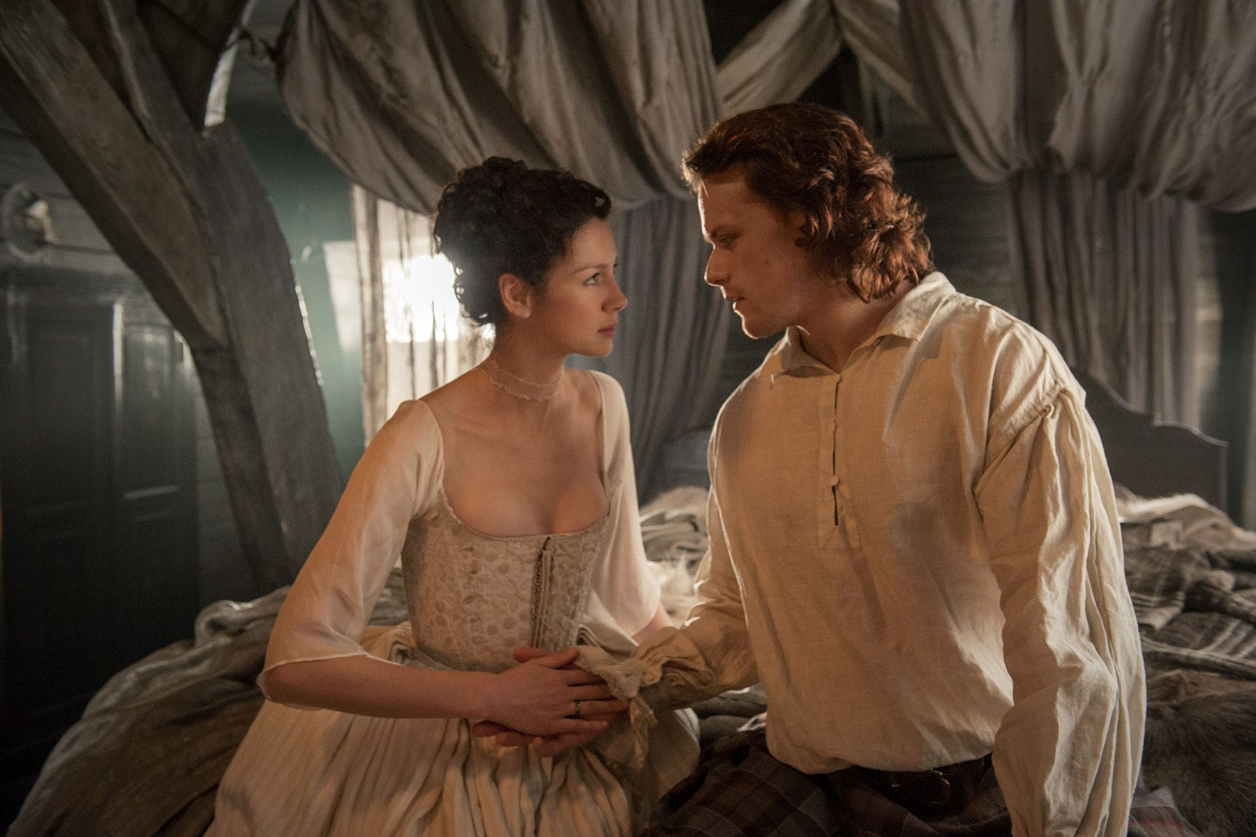 Claire (Caitriona Balfe) and Jamie (Sam Heughan) on their wedding night | Outlander on Starz