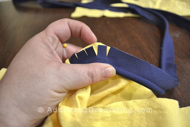 Sewing piping to upholstery tips.
