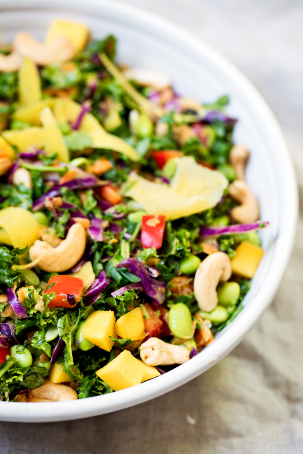 Chopped Thai Kale Salad with Peanut Ginger Dressing Vegan and gluten free chopped Thai Kale Salad with edamame, mango and veggies. Tossed with a flavorful peanut ginger dressing. A great lunch.