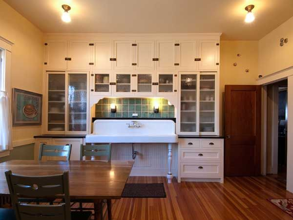 Bungalow Kitchen With Wide Sink And Glass Front Cabinets Bungalow Kitchen Craftsman Kitchen Kitchen Inspirations