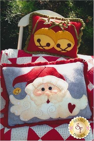 Jingle Bell Santa Pillows Pattern: Create these two darling jingle bell and Santa pillow to add cheer to your home this Christmas! Finished pillow sizes are measured at 12
