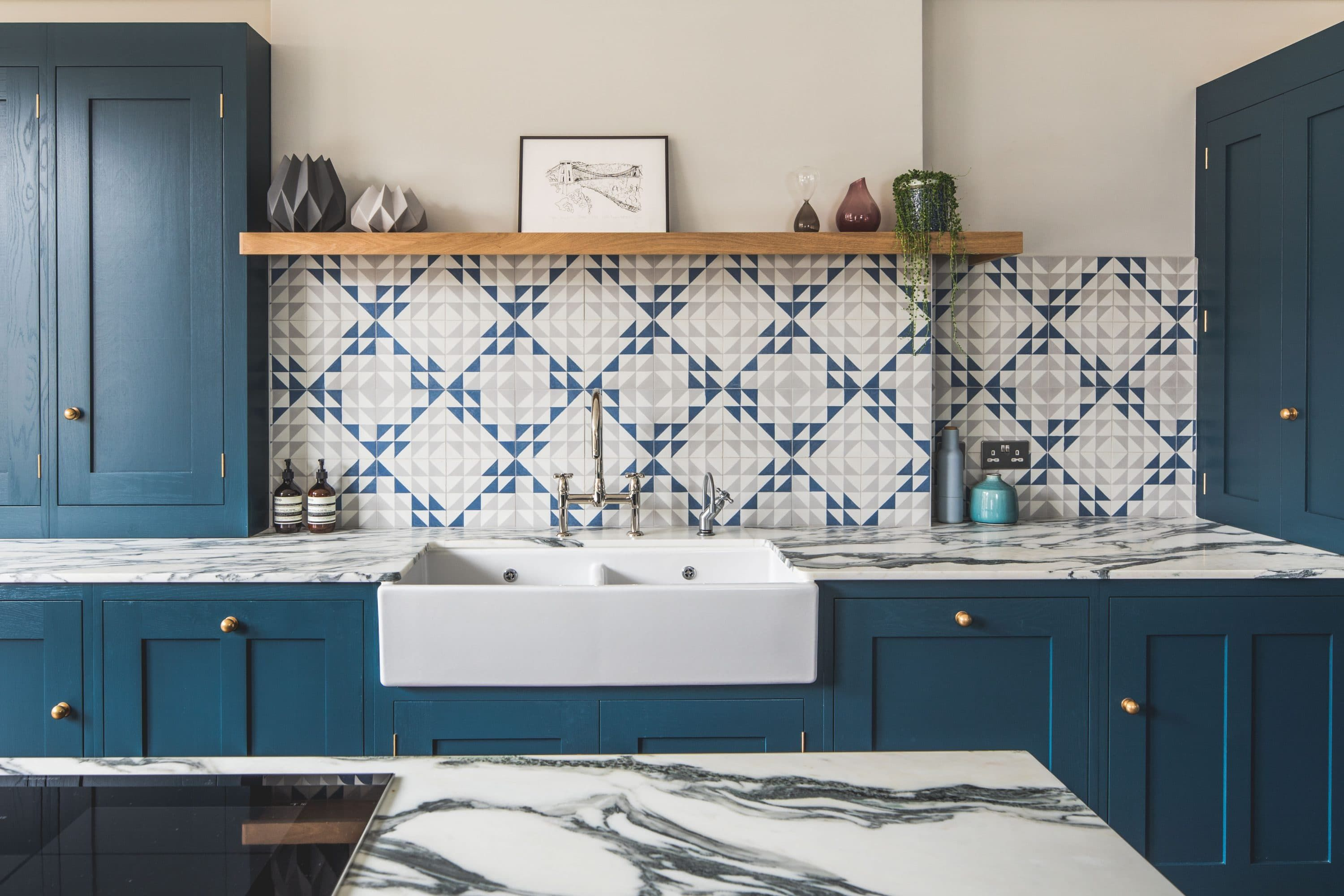This Imposing Dark Blue Shaker Style Kitchen Wows With A Geometric Bert Amp May Tiled Wall Geometric Kitchen House Decoration Kitchen Shaker Style Kitchens