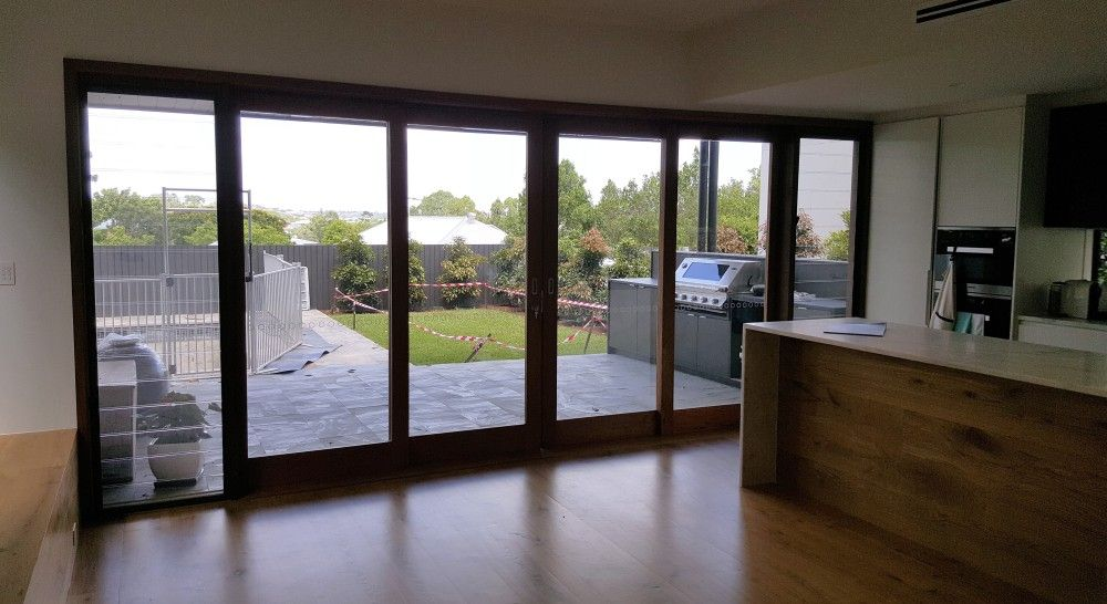 Centre Opening Timber Sliding Doors Stacking Externally Over Wall
