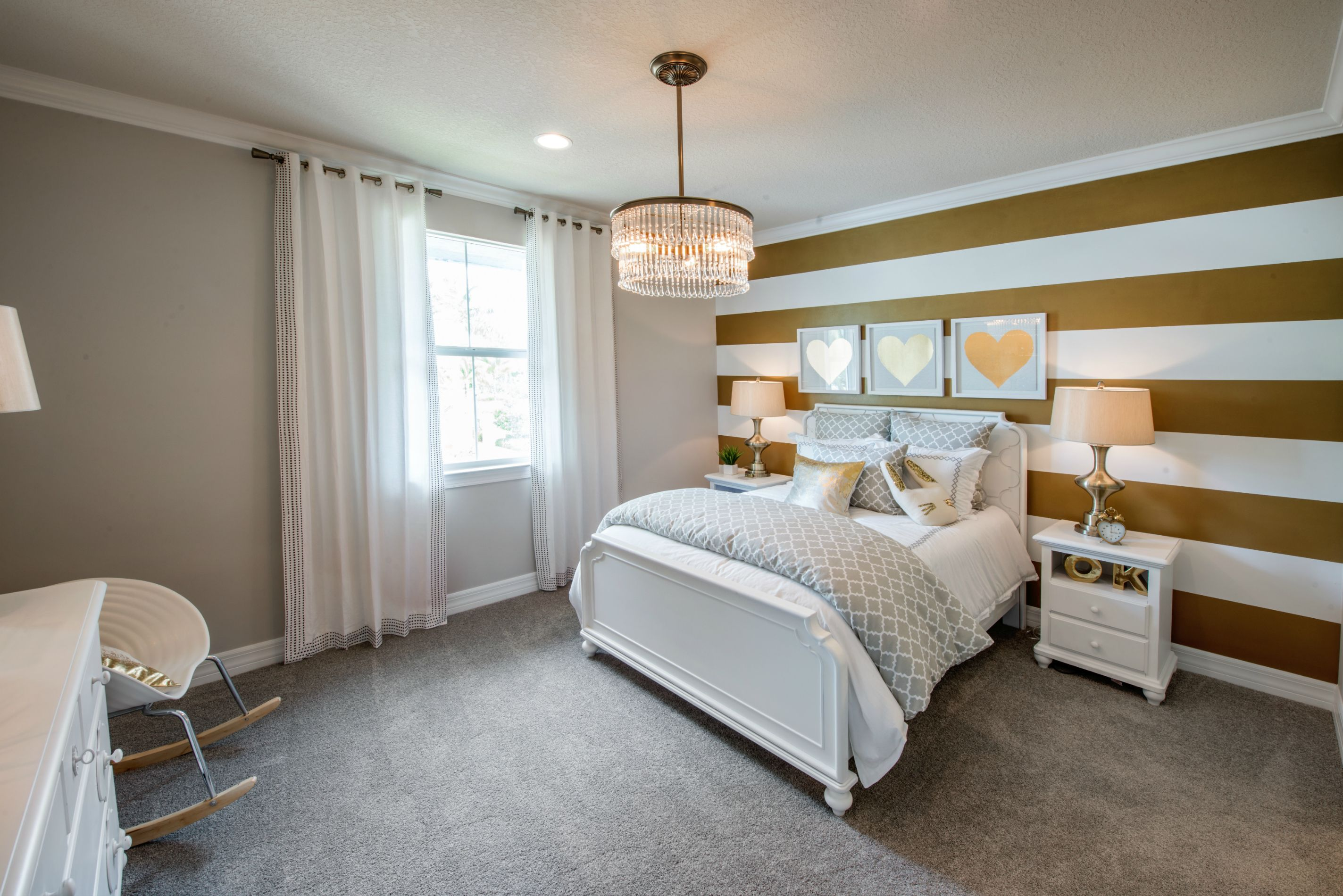 An Accent Wall In Gold Stripes Makes This Neutral Girl S Bedroom