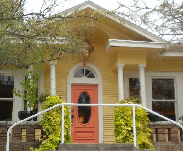 yellow houses with orange doors austin texas daily photo curb appeal series architecture. Black Bedroom Furniture Sets. Home Design Ideas