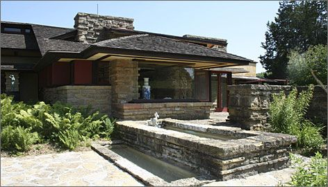 Frank Wright Architect nestled on a hillside overlooking the river, wright's taliesin