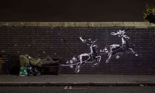 Red noses appear on Banksy's Birmingham homeless reindeer mural
