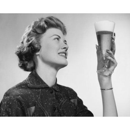 Close-up of a young woman holding a glass of beer Canvas Art - (24 x 36)
