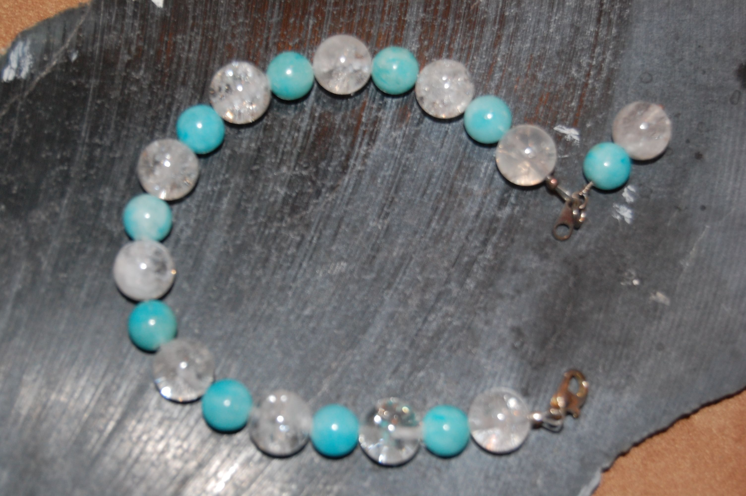 """Crackle Me Up"".    White/clear crackle beads strung with aqua blue glass rounds and Crystal Quartz.  This little charmer is sweet.    #18b         Finished length 7.75"".    $25.00"