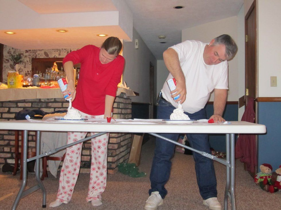 3. Whipped Cream Tannenbaum – Each player gets 2-3 cans of whipped cream. They have 1 minute to make the tallest Christmas tree. Player with the tallest Christmas tree after 1 minute is the winner.