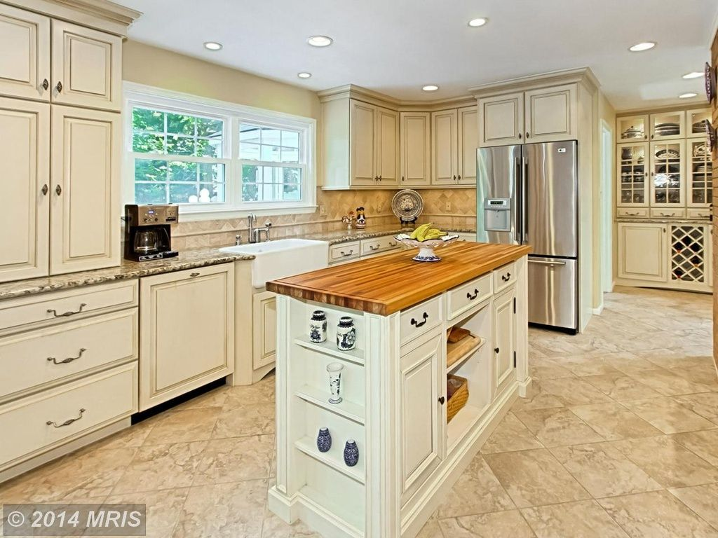 Traditional kitchen with torino italian porcelain tile elements traditional kitchen with torino italian porcelain tile elements series fire limestone tile floors dailygadgetfo Image collections