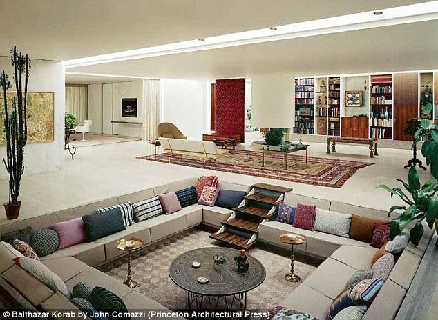 A rare colour photograph shows a classic 1960s sunken living room, complete with brightly coloured cushions and storage wall, at Miller House.