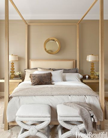 """Designer Benjamin Dhong balanced the """"masculine strength"""" of the custom bed in a San Francisco row house with a vintage Curtis Jere brass porthole mirror and gold Murano glass lamps by Steve Jensen from William Switzer: """"I like the geometry of clean, straight lines and hard angles, but it can be oppressive. Circular elements are compelling and very human."""