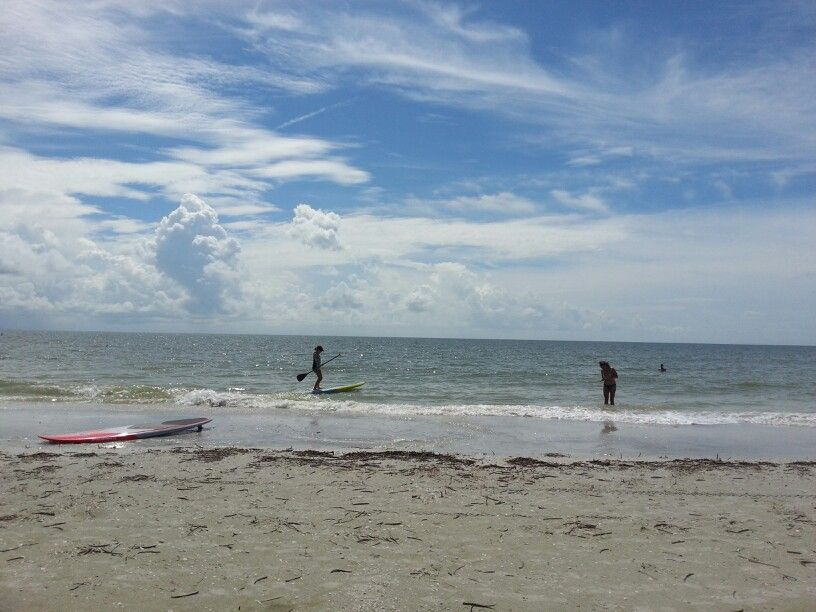 Paddling the SUP with beach beauties at Fulgar Beach off